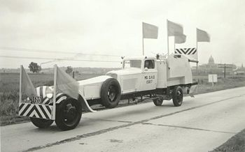 A striping vehicle from the 1930s. The extended front functioned like a long scope, helping the driver stay true so he could place paint accurately.