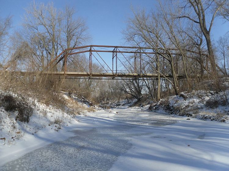 The Historic Big Creek Bridge – an 8-panel, pin-connected Camelback through truss bridge