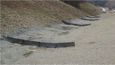 The grade of a ditch and the three-dimensional ditch checks that were installed.
