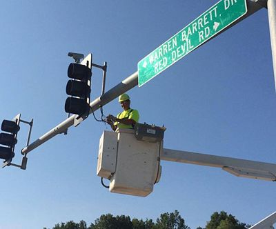Sr. Electrician Mike Laks replaces signal lights at the intersection of Warren Barrett Dr. and U.S. 61 in Hannibal.