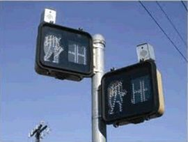"A ""Signal Head, Type 11S, Pedestrian"", as noted on the D-37A sheet, is a two-face, side-of-pole mounted pedestrian indication. Thus, one signal post will have two pedestrian indications, one for NB/SB crossing and one for the EB/WB crossing, as shown above."