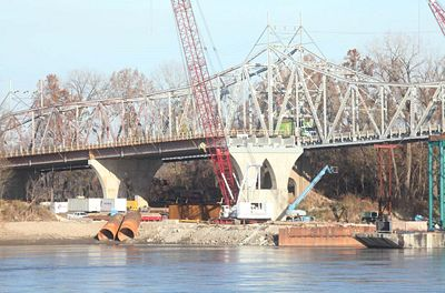 Alberici Constructors, Inc. crews continue work on the Rte. 47 Missouri River Bridge at Washington.  The new $63 million bridge will be open in late 2018 and the current bridge, built in 1936, will thereafter be demolished. (Photo by Jeanne Wood with the Missourian.)