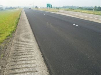The refurbished material is ready for a new asphalt overlay without leaving the site. This photo shows I-29 after the hot in-place recycling treatment.