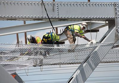 Saffo Contractors employees perform prep work for maintenance of the Missouri River Bridge at Jefferson City.  For about 4 months, the westbound bridge will be closed for painting and repairs.