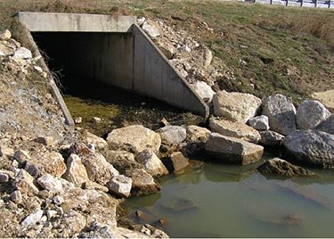 Gabion baskets, large rock and erosion blanket were placed to repair and protect the streambank.