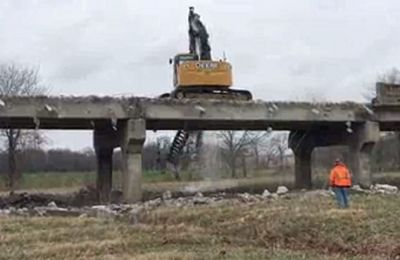 The Carthage  Press videoed Clarkson Construction employees demolishing the Rte. 96 bridges to be replaced over the Spring River overflow east of Carthage.