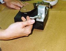 Applying blows by turning the handle