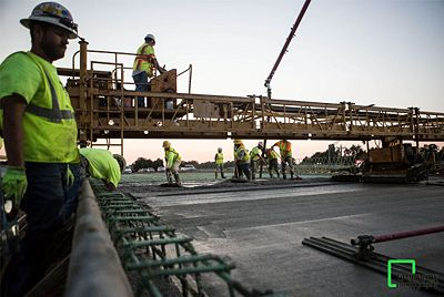 Joe Thomas of Greenbox Photography captured this shot of the concrete pour for the new U.S 60 bridge over Rtes. B/VV in Rogersville.  Next, the bridge walls are to be constructed along with new U.S. 60 pavement leading up to the bridge.  The U.S. 60 Rogersville project is being designed and built by Ozark Regional Road Constructors, a team of engineering and construction companies.