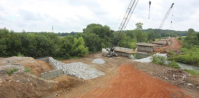 A new, wider Rte. 171 bridge is being built over Center Creek in Carl Junction. The original bridge, built in 1955, required costly maintenance and is being replaced in the $2.8 million project by Capital Paving & Construction.