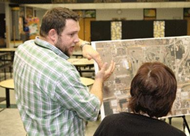 Resident Engineer Jason Evenden talks with a customer at an open house meeting about planned improvements to Rte. 60 in Neosho. The project is a partnership with the City of Neosho and the Neosho Transportation Development District.