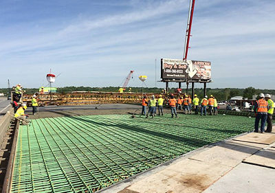 Crews pour the final deck of the westbound I-70 Manchester Bridge. Also, the eastbound Hwy 40 on-ramp is now open.