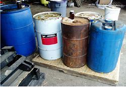 Drums of material improperly stored and not all containers are labeled