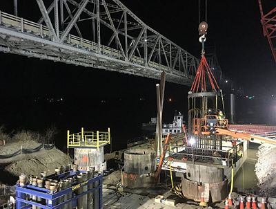 Work continues on the Rte. 47 Missouri River Bridge construction site.  The project, awarded to Alberici in 2016 for almost $63 million, will replace the narrow 1936 bridge by late 2018. The new bridge will have two 12 ft. lanes, 10 ft. shoulders on the inside and outside, and a 10 ft. protected bike/pedestrian path as well as decorative lighting, railing details and decorative columns.